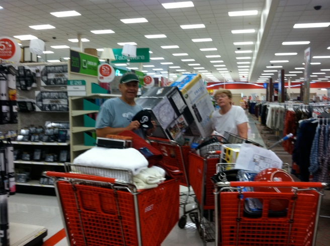 My mother-in-law and father-in-law at Target yesterday (yes 4 carts, we had 6 at checkout)
