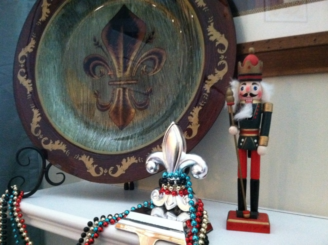 Don't you just love my fleur-de-lis stocking holders and the charger on my fireplace mantel? I'm obsessed with the fleur-de-lis.  I found the fleur-de-lis stocking holders at Hobby Lobby for $7.50 each. I gave the nutcracker to my hubby when we first met.